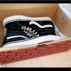 Black and White Woman's 7.5 High Top  Vans